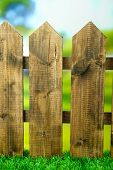 Wooden fence with protected varnish, on bright background