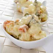 some small bowls with typical spanish ensaladilla rusa, russian salad, served as tapas