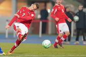 VIENNA,  AUSTRIA - MARCH 22 Marko Arnautovic (#7 Austria) kicks the ball during the world cup qualif