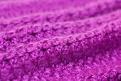 openwork knitting of purple yarn as a texture