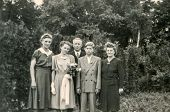 GERMANY, JUNE 26, 1950 - Vintage photo of family outdoor - Jugendweihe (youth consecration), a secular coming of age ceremony practiced by German 14-year-olds.