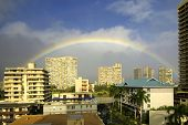 picture of waikiki  - Rainbow over top of buildings in Waikiki - JPG