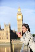 picture of westminster bridge  - London woman drinking coffee happy by Big Ben laughing - JPG