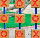 picture of tic  - wooden tic tac toe in a green park - JPG
