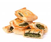 Puff pastry bun isolated on white background. Healthy patty with spinach.