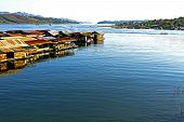 stock photo of houseboats  - Houseboat on blue water in Sangklaburi Kanchanaburi country Thailand - JPG