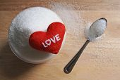 Text Love On Sugar In A Cup On Wood Table Background