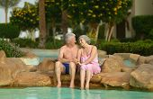 Senior couple relaxing at pool