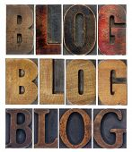 blog word in isolated antique wood letterpress printing blocks, stained by color inks, a collage of