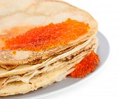 Delicious pancakes with red caviar isolated on white