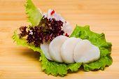 Fresh Fish Sashimi On A Wooden Textured Desk