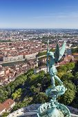 Lyon, France, viewed from the top of Notre Dame de Fourviere, with statue of St George.