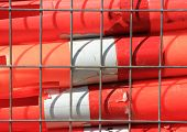 Orange Warning Tubes In Metal Grid