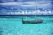 Little fishing boat in blue sea, beautiful peaceful seascape background, clear transparent water of