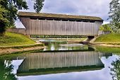 foto of water-mill  - Reflected on still water with a stormy sky above Indiana - JPG