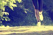Sports girl runs in park effect films