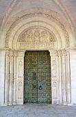 San Clemente abbey, bronze portal and sculpted tympanum, Abruzzo region, Italy