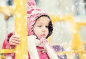 Baby girl playing on winter playground