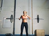 Crossfit Young Woman Lifting Heavy Weights