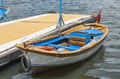 Small Wooden Motor Boat Moored Up