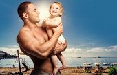 Loving Father With Daughter Against Beach Background