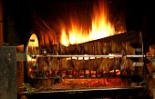 pic of spit-roast  - fire lit in the fireplace and the spit which runs very fast with meat - JPG