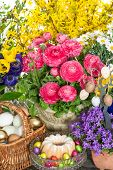 Spring Flowers, Chocolate Easter Eggs And Cake