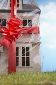 Gift-Wrapped House With Red Bow