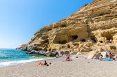 Pebbly Beach Matala, Greece Crete. Matala Has Become Famous For Artificial  Neolithic Caves, Carved