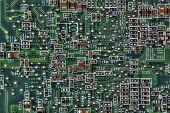 foto of microprocessor  - Closeup of a dusty dirty green computer microprocessor motherboard - JPG
