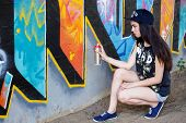 Street, outdoor. Attractive teen in a cap