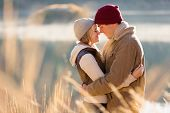 loving young couple in autumn morning by the river