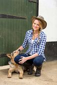 happy country girl and her dog inside farm house