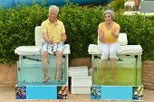 Senior couple on procedure for foot care