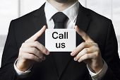 Businessman Holding Card Call Us