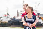 Couple enjoying vacation at German north sea ship pier in harbor
