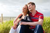 Couple enjoying vacation in German north sea beach dune