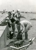 GERMANY, CIRCA FORTIES - Vintage photo of group of people changing on beach