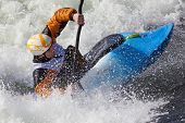 pic of life-boat  - an active male kayaker rolling and surfing in rough water - JPG