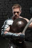 Gladiator with shield and sword