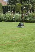 View of a lawn mower on lawn against plants
