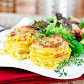 stock photo of carbonara  - spaghetti carbonara with mixed salad on plate - JPG