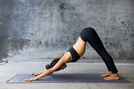 foto of yoga  - Young woman practicing yoga in a urban background - JPG