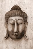 Antique Buddha carving on the wooden wall