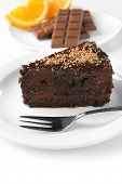 Yummy chocolate cake served on table