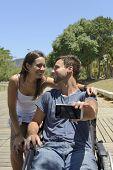 foto of wheelchair  - Man in wheelchair and girlfriend taking a selfie with smartphone - JPG