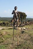 The African Boy On Stilts