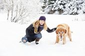 girl and golden retriever