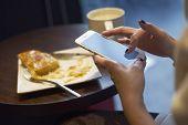 Girl Using Cellphone At Breakfast