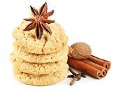 Christmas spices and cookies isolated on white
